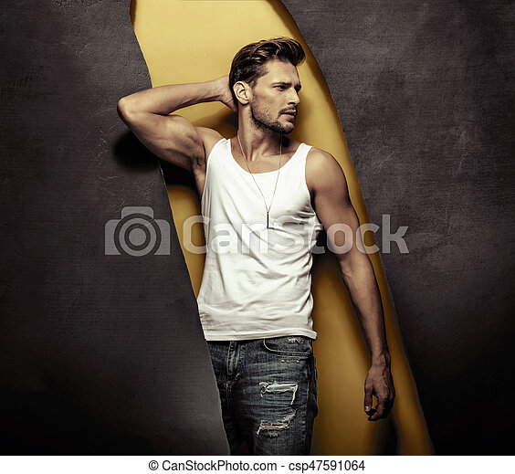 Fashion style portrait of a musular, handsome man - csp47591064
