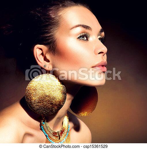 Fashion Woman Portrait. Golden Jewels. Trendy Makeup  - csp15361529