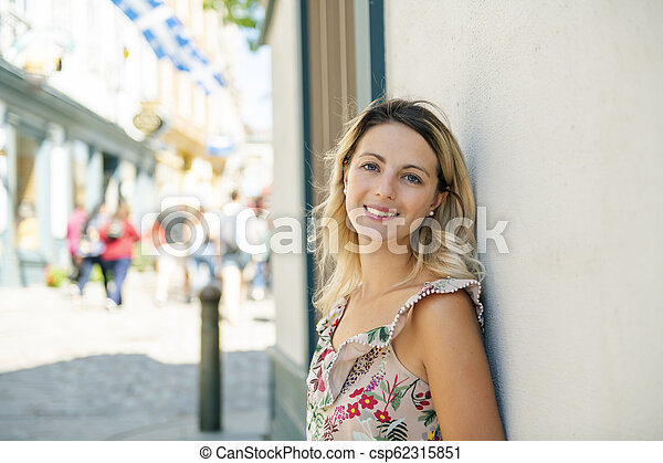 Fashion woman portrait of young pretty trendy woman posing on the quebec city street - csp62315851