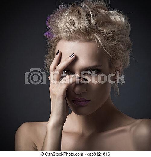Fashion woman portrait on dark background - csp8121816