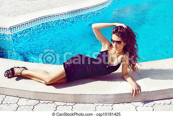 Fashion woman sunbathing near swimming pool outdoors - Where is my nearest swimming pool ...