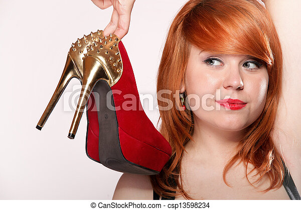 Fashion woman with red high heel shoes - csp13598234