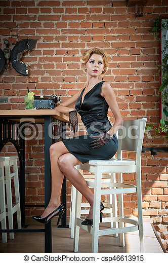 Fashionable Attractive Lady With Little Black Dress And Gloves