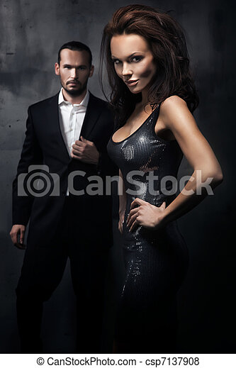Fashionable couple in a dark room - csp7137908