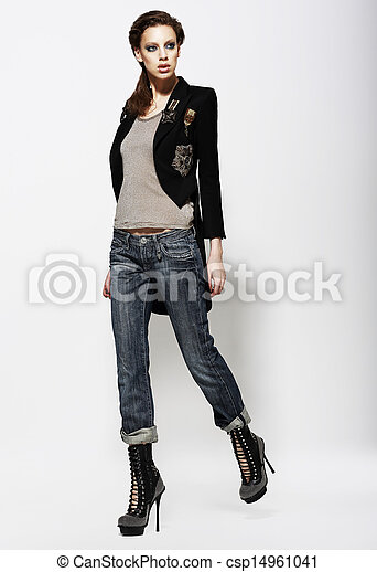 Fashionable Glamorous Woman in Jeans and High Boots. Vogue Style - csp14961041