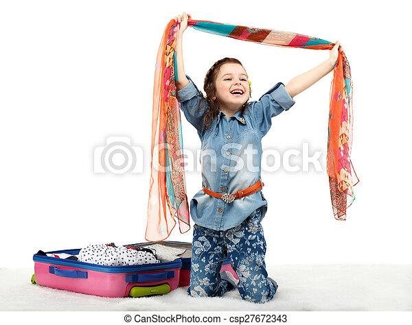 Fashionable little girl unpacking a suitcase - csp27672343