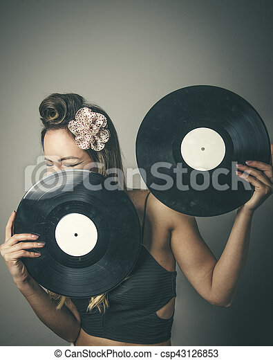 Fashionable woman with two vinyl LP records - csp43126853