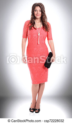 fashionable young woman in fashionable red dress . - csp72228032
