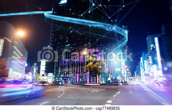 Fast connection in the city at night. Abstract technology background - csp77489835