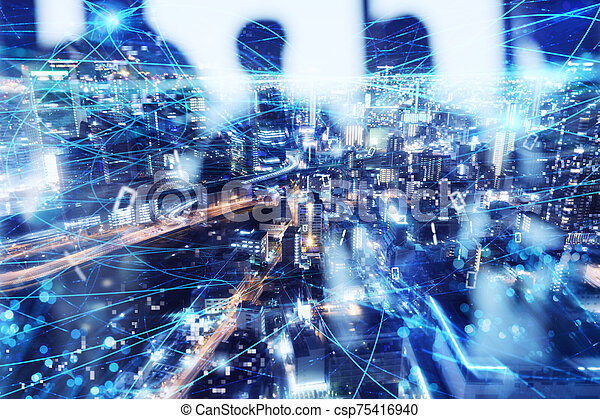 Fast internet connection in the city at night. Concept of technology and innovation - csp75416940