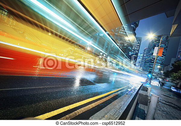 Fast moving bus at night - csp6512952