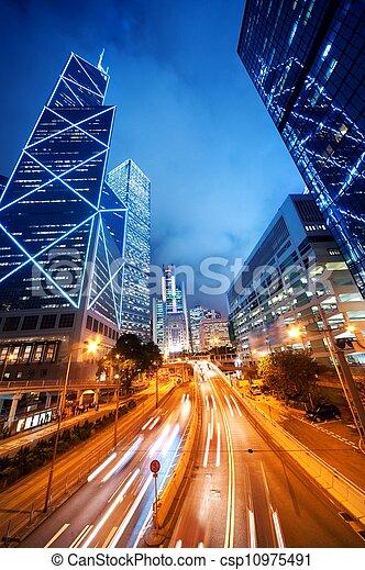 Fast moving cars at night - csp10975491