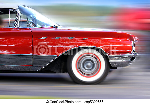 Fast moving classic red car - csp5322885