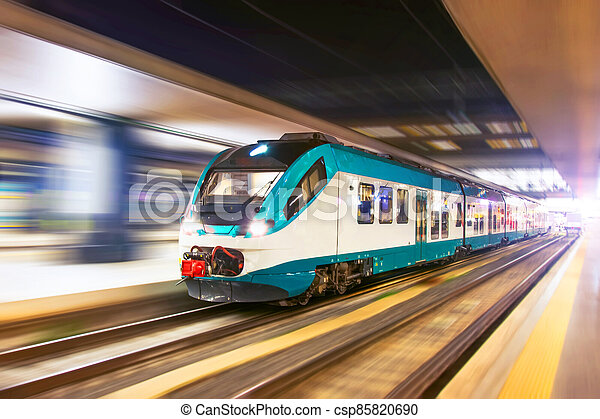 Fast night city train with motion blur. - csp85820690
