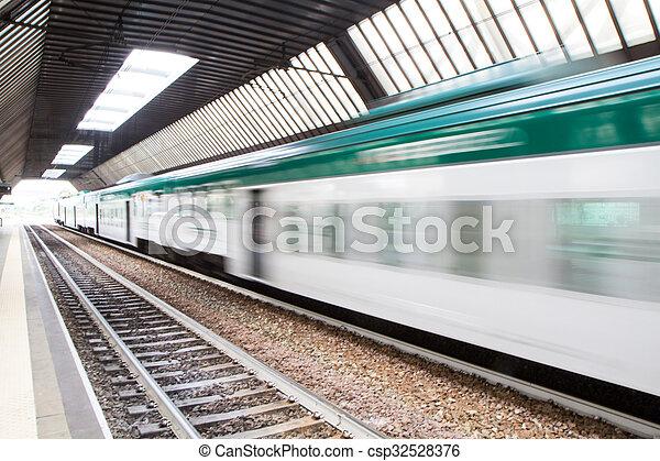 Fast Passenger Commuter Train with Motion Blur - csp32528376