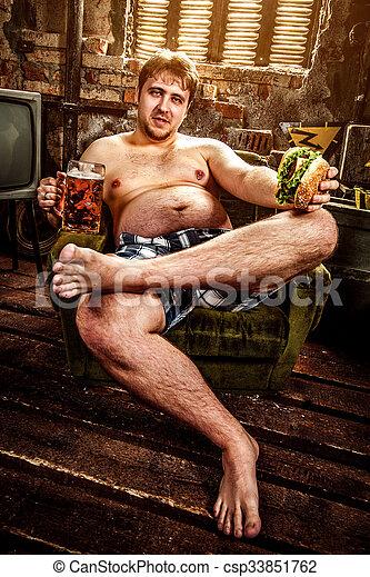 fat man eating hamburger - csp33851762