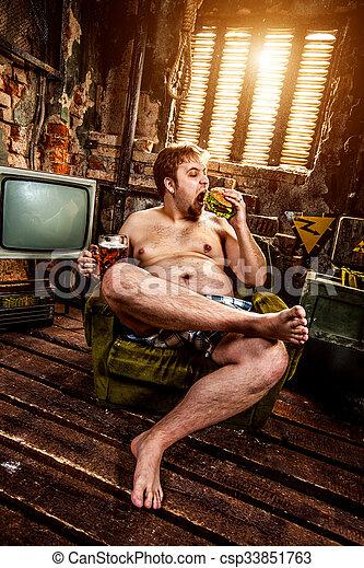 fat man eating hamburger - csp33851763