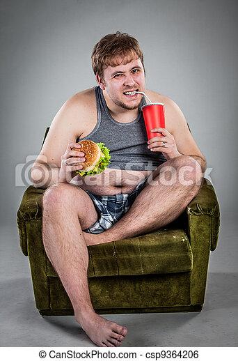 fat man eating hamburger - csp9364206