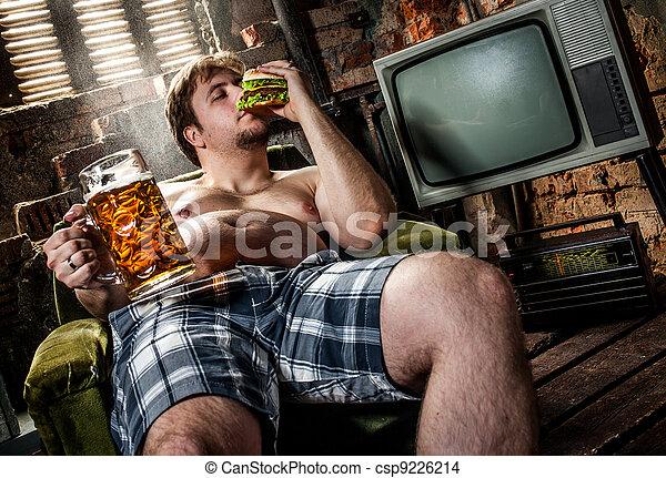 fat man eating hamburger - csp9226214