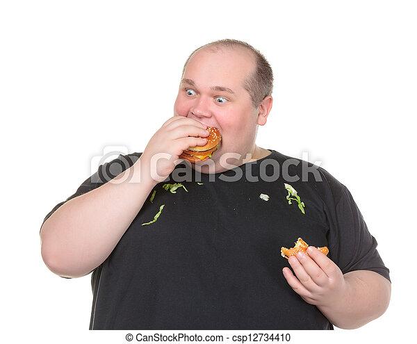Fat Man Greedily Eating Hamburger - csp12734410
