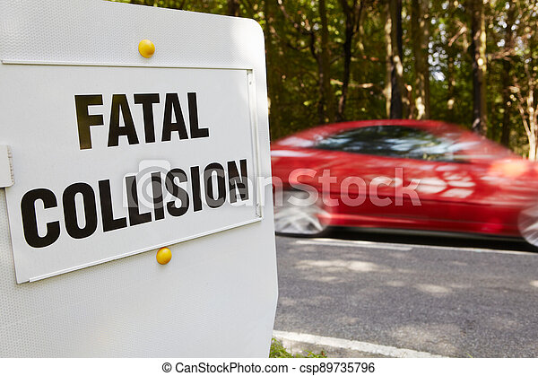 Fatal Collision Sign Next To Scene Of Accident On Busy Road - csp89735796