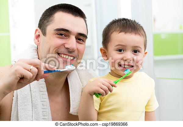 father and child boy brushing teeth before going to bed - csp19869366