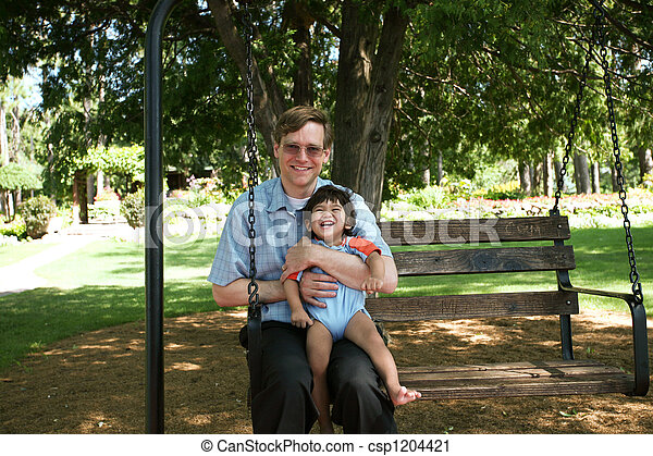 Father and child swinging - csp1204421