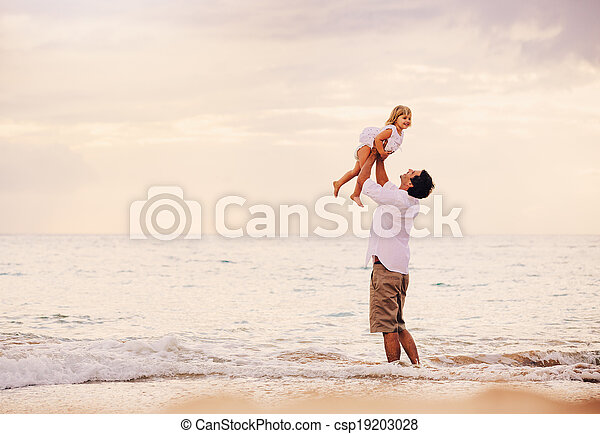 Father and Daughter Playing Together at the Beach at Sunset - csp19203028