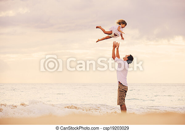 Father and Daughter Playing Together at the Beach at Sunset - csp19203029
