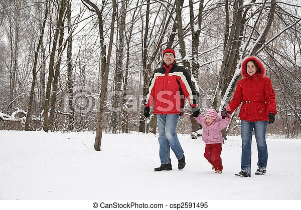 father and mother walk in park with child at winter - csp2591495