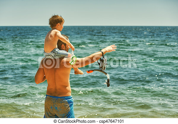 Father and son having fun at sea - csp47647101