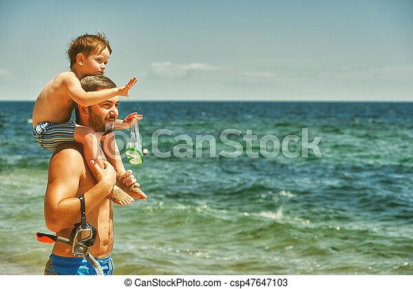 Father and son having fun at sea - csp47647103