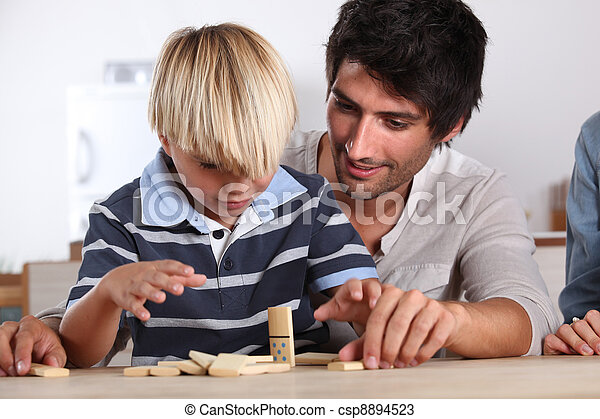 Father and son playing domino - csp8894523
