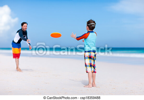Father and son playing frisbee - csp18359488