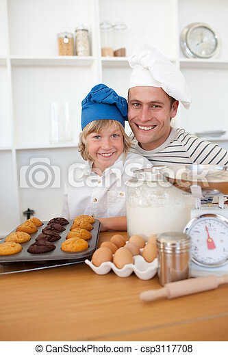 Father and son presenting their muffins - csp3117708