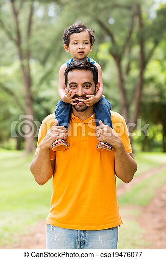 father carrying son on his shoulders - csp19476077
