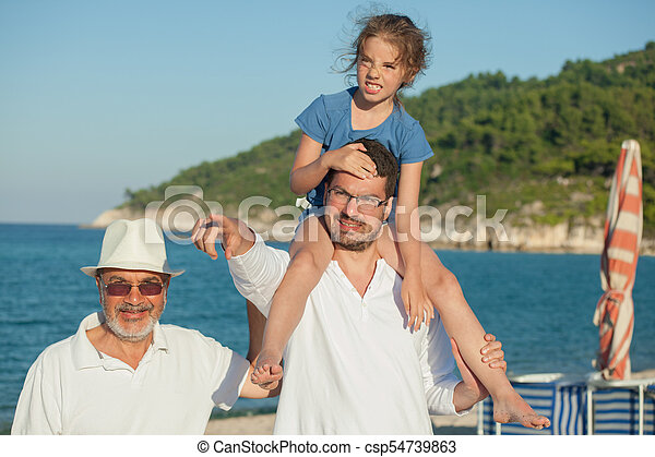 Father Daughter Shoulders Grandfather Sea Beach - csp54739863