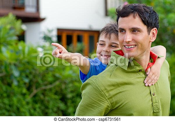 Father giving his son a piggyback ride - csp6731561