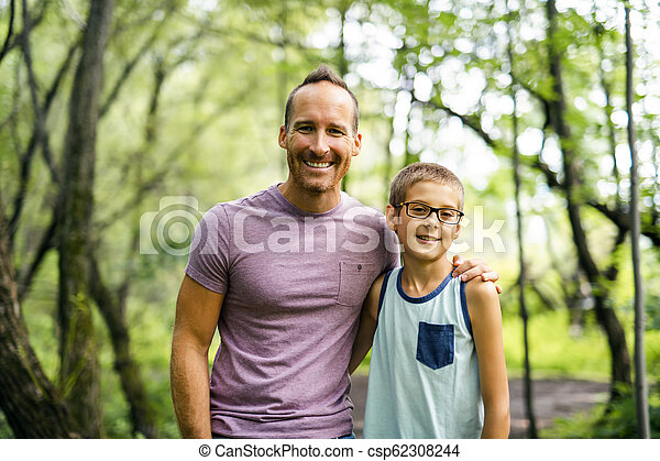 Father giving his son a piggyback ride, having fun - csp62308244