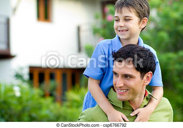 Father giving his son a piggyback ride - csp6766792