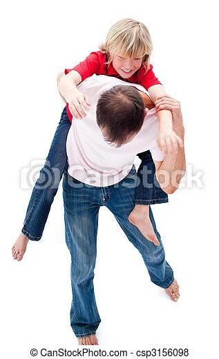 Father giving his son piggyback ride  - csp3156098