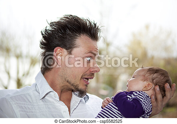 father joking with baby girl a happy father making faces and joking