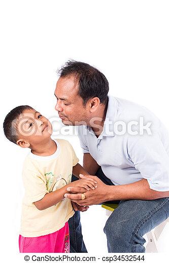 father kiss his son - csp34532544