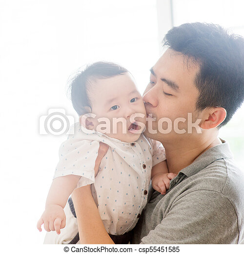 Father kissing baby boy. - csp55451585