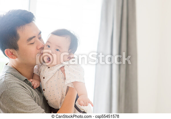 Father kissing baby child. - csp55451578