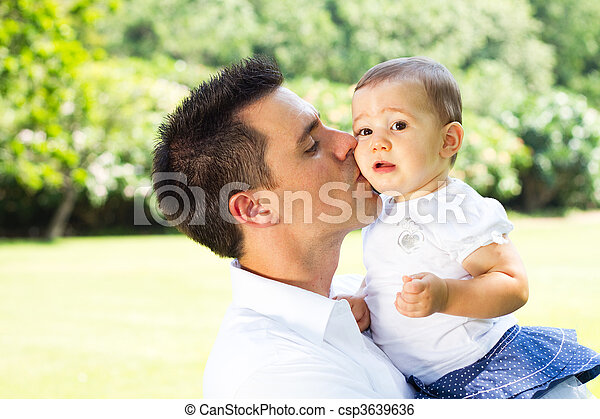 father kissing baby daughter - csp3639636