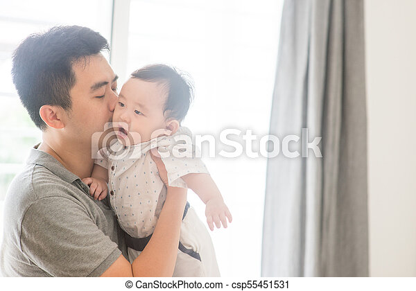 Father kissing baby son. - csp55451531