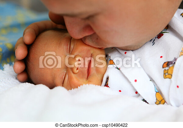 Father kissing baby - csp10490422