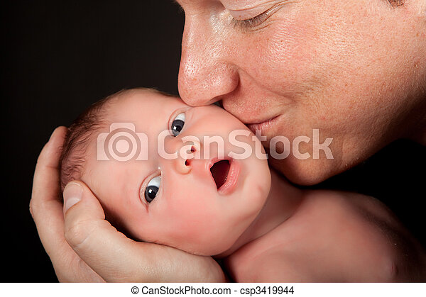 Father kissing baby - csp3419944