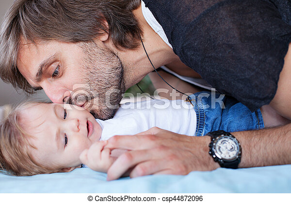 Father kissing baby - csp44872096